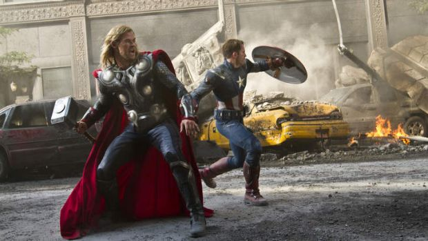 Chris Hemsworth as Thor, left, and Chris Evans portrays Captain America in a scene from <i>The Avengers</i>.