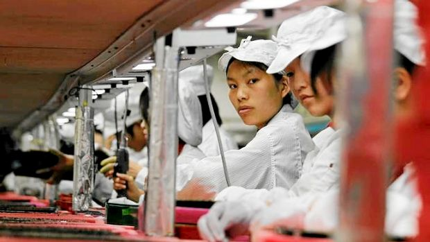 Workers are seen inside a Foxconn factory in Longhua, China in 2010. Foxconn, a major supplier of Apple was said to be ...