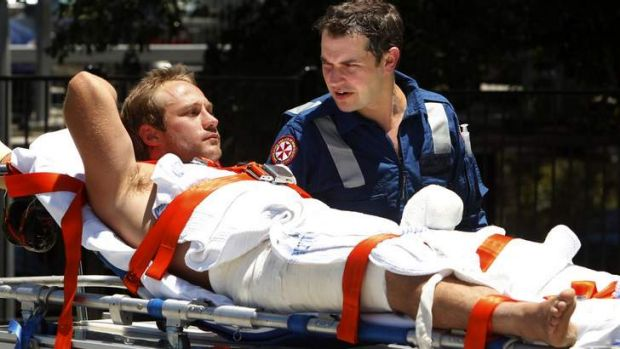 A man is airlifted to John Hunter Hospital after apparently being attacked by a bull shark at Diamond Head.