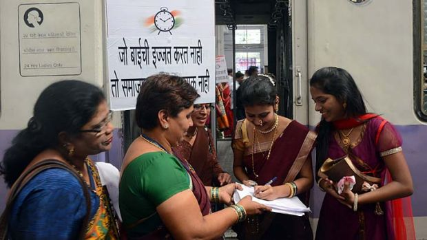 Making their voices heard ... women in New Delhi sign a petition condemning the recent gang rape.