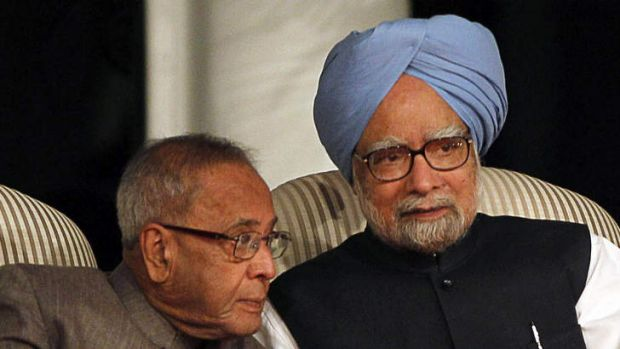 Prime Minister Manmohan Singh (right) confers with his finance minister.