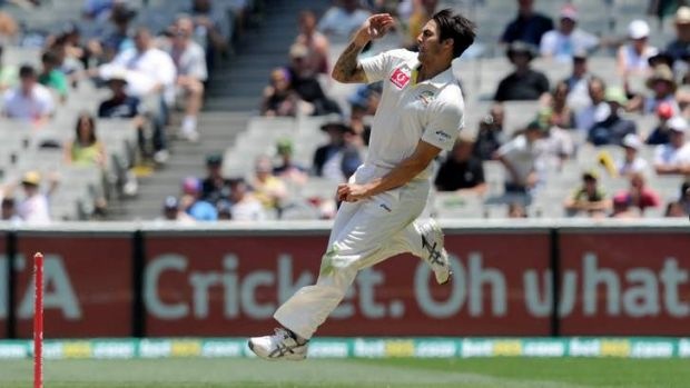 Mitchell Johnson charges in against Sri Lanka at the MCG on Friday. Johnson made 92 not out and captured six wickets for ...