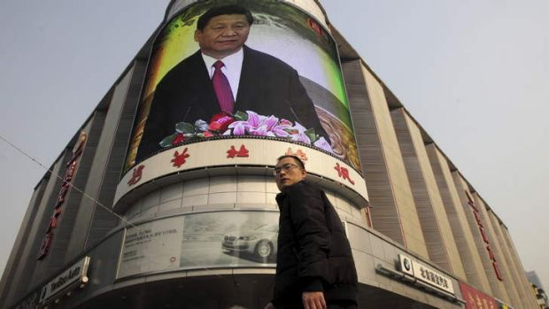 Power transition: A Beijing man walks past a monitor broadcasting a news conference held by Xi Jinping, the general ...