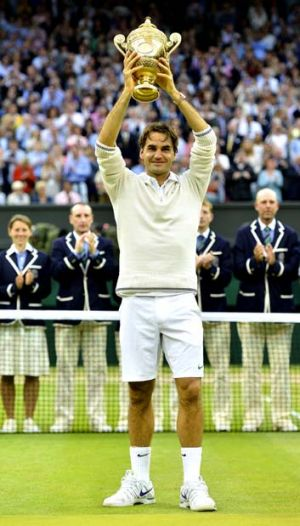 Still a winner ... Roger Federer with this year's Wimbledon trophy.