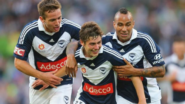 Party time: Matthew Foschini and Archie Thompson get around goalscorer Marco Rojas on Friday night. Victory won an ...