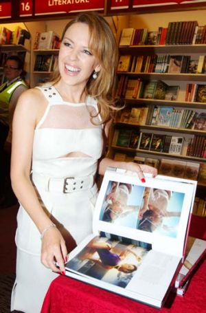 Kylie Minogue shows off a new book charting the singer's style over the past 20 years.
