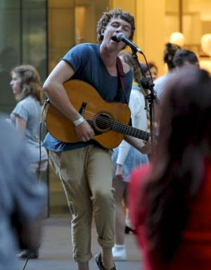 On song … busker James Draper performs in Pitt Street Mall.