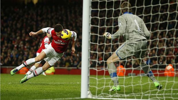 Arsenal's Olivier Giroud heads and scores his first goal past Newcastle United goalkeeper Tim Krul.