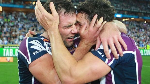 Champions ... Melbourne Storm captain Cameron Smith and Billy Slater celebrate their grand final win.