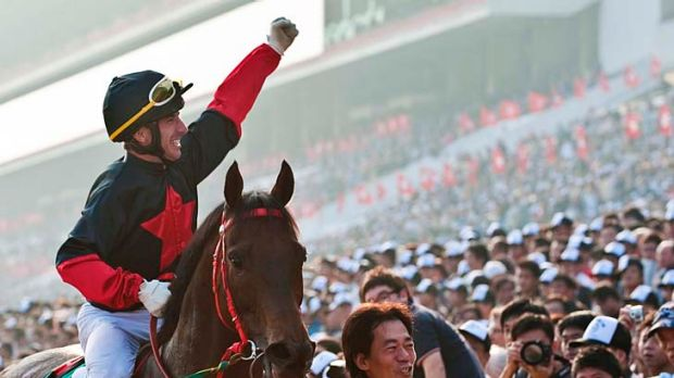 Top of the world: Olivier Doleuze and Good Ba Ba in winning form in Hong Kong.