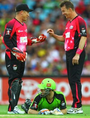Up you get … Brad Haddin and Brett Lee banter with the Thunder's Ryan Carters.