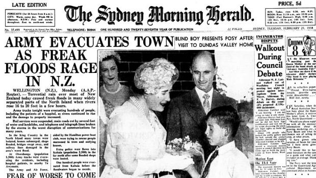 The front page of the Sydney Morning Herald on February 25, 1958 shows the late Queen Mother receiving flowers from ...