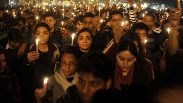 Indian protesters hold candles during a rally in New Delhi, after the death of a gang rape victim from the Indian capital.