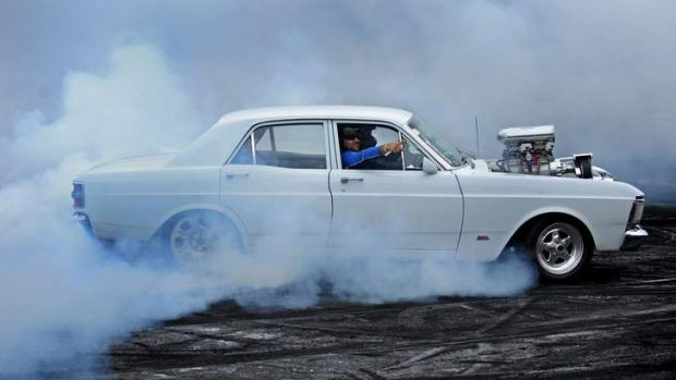 Smokin': Don Elphick in his 1971 Ford Falcon XY.
