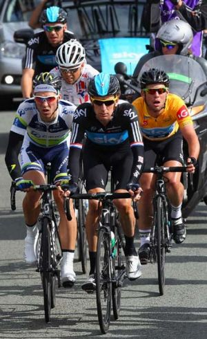 Next in line: Leigh Howard, left, and Mark Cavendish, right, on Bradley Wiggins' wheel in the Tour of Britain.