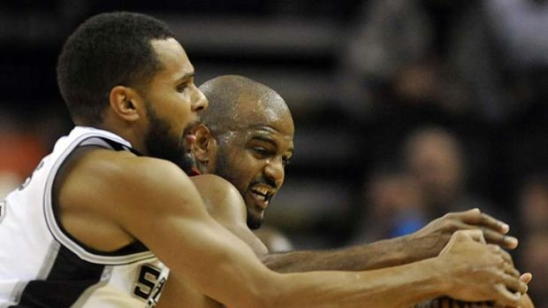 Fierce competitor: Australia's Patty Mills (left) is helping San Antonio push for an NBA title.