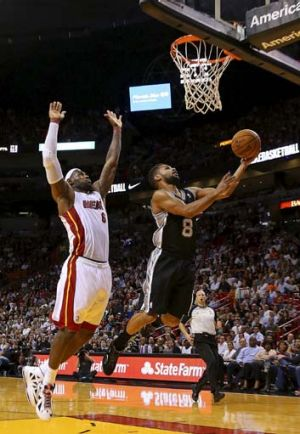 Court of dreams ... Patty Mills goes for a lay-up with Miami star LeBron James in pursuit.