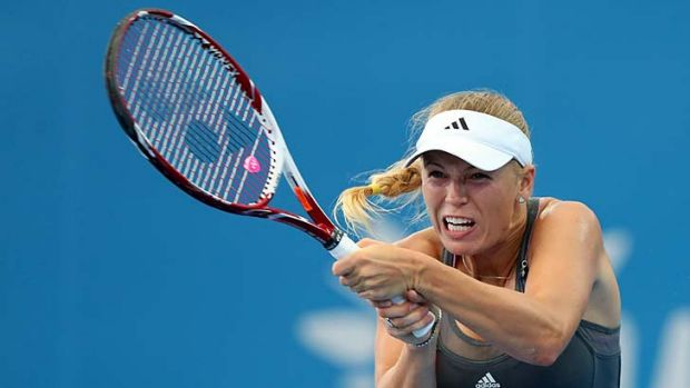 Roll on 2013 ... Caroline Wozniacki crashes out.