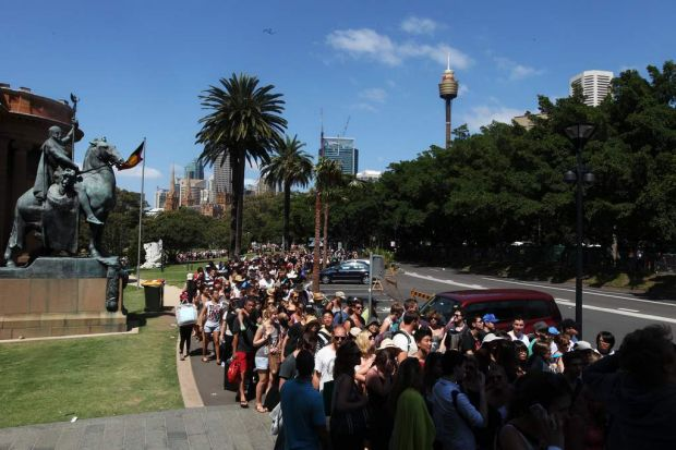 Thousands line up in the Domain and Art gallery area for entry to Mrs Macquaries chair for New Years Eve.