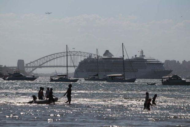 A large passenger ship blocks the Sydney Harbour Bridge from party-goers at Dumaresqu Reserve, Rose Bay.