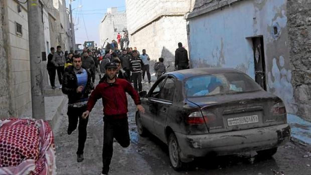 Residents flee an air strike by a fighter jet loyal to Syrian President Bashar al-Assad in Aleppo's al-Marja district on ...