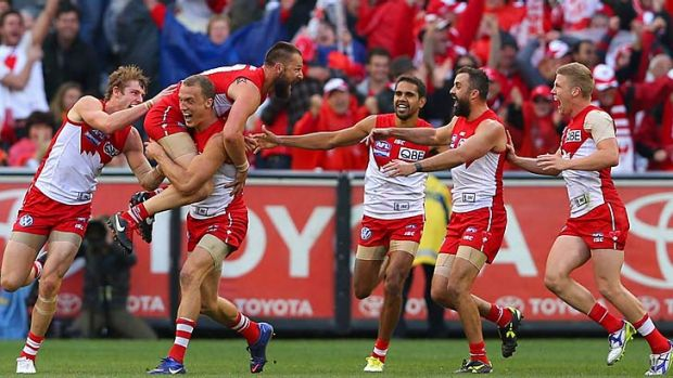 Nick Malceski of the Swans is congratulated by team-mates after kicking the final goal of the 2012 AFL Grand Final.