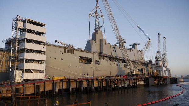 CAPITAL AFLOAT: HMAS Canberra is almost 28,000 tonnes. The combined cost of Canberra and its sister ship, Adelaide, will ...