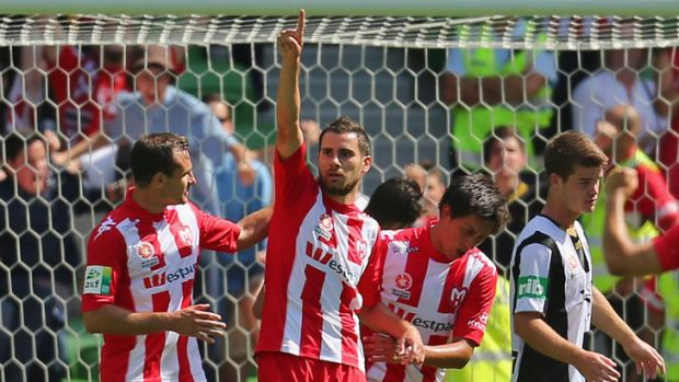 Josip Tadic celebrates after scoring Heart's second goal.