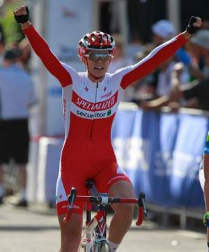 You beauty: Kimberley Wells celebrates her win in the criterium event on Tuesday.