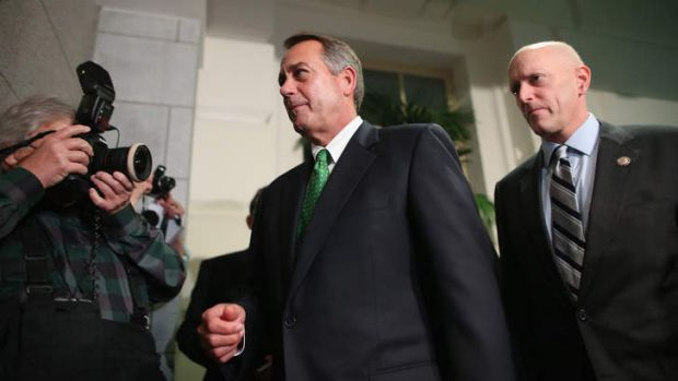 Speaker John Boehner (centre) after a meeting where Republicans discussed the controversial bill.