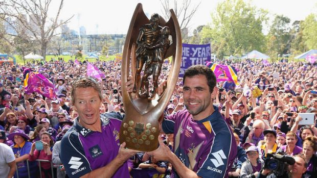 Craig Bellamy and Cameron Smith with the premiership trophy. The club hopes Bellamy will sign a new deal.