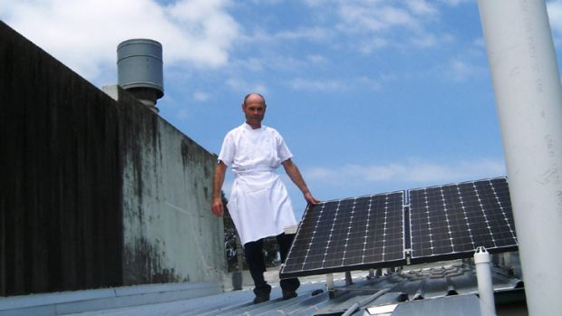 Restaurateur Philippe Pinson believes his 15 solar panels - fitted at a cost of $12,000 - should save about $200 each ...