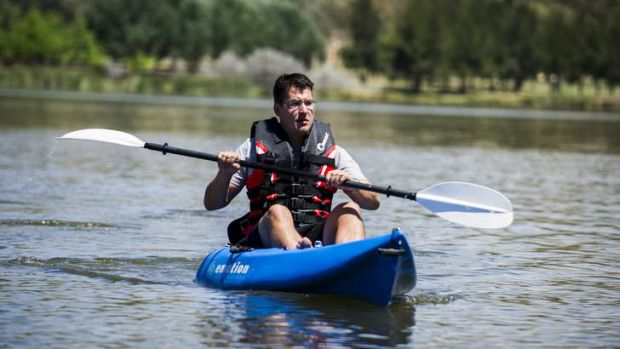 Zed Seselja kayaking on Lake Tuggeranong before heading to Batemans Bay for a much-needed holiday with his family.
