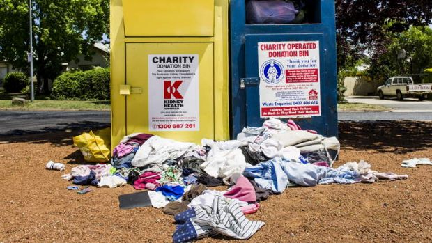 Clothes and other rubbish dumped outside of charity bins at Ainslie shops.