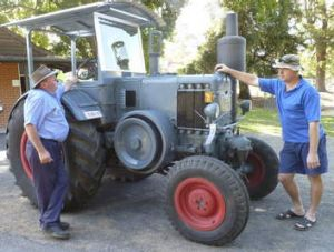 Ross Umbers and his son Glen inspect a Lanz Bulldog tractor.
