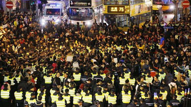Standstill … there was a heavy police presence as protesters blocked main thoroughfares in Hong Kong on New Year's day.