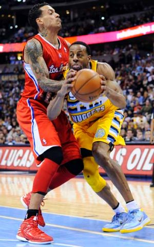Denver Nuggets guard Andre Iguodala (right) drives past Los Angeles Clippers forward Matt Barnes during the fourth quarter.