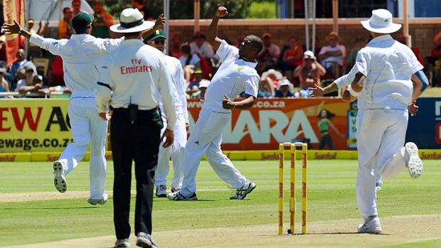Vernon Philander celebrates after taking his fifth wicket in New Zealand's first innings.