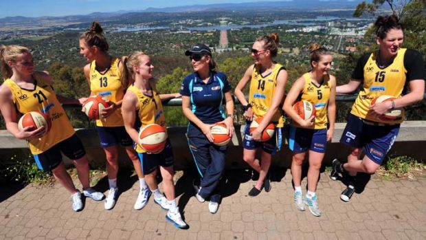 The Canberra Capitals sporting their special Canberra Centenary golden uniform atop Mount Ainslie.