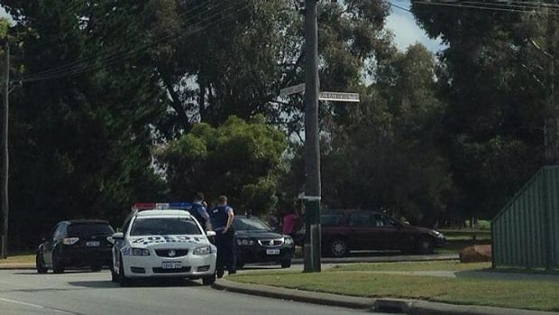 Police assemble at the corner of Woodpecker Avenue and Albatross Pass in Willetton, where they are involved in a ...