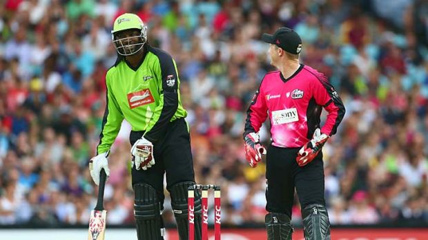 """Just one of those things"" ... Chris Gayle and Brad Haddin exchange words."