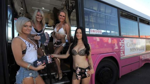 PRETTY IN PINK: Dancers Crystal, Lucy, Mercedes and Tatianna with the bus that will be available to ferry Summernats ...