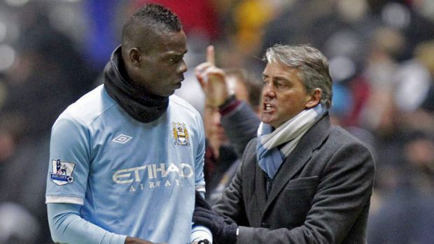 Training ground bust-up ... Roberto Mancini and Mario Balotelli.