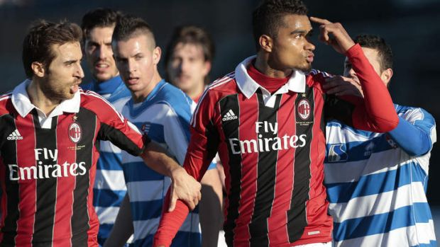 Racism protest ... AC Milan midfielder Kevin-Prince Boateng gestures towards the crowd.