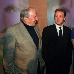 Paul McCartney speaks with composer Sir Richard Rodney Bennett, left, in New York in 2000. (AP Photo/Stephen Chernin)
