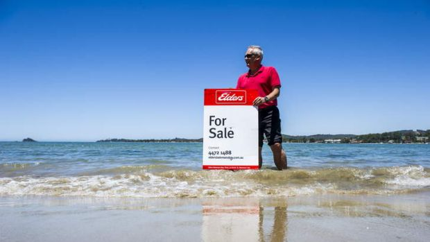 Elders Batemans Bay principal, Greig McFarlane, with a for sale sign at the small piece of land he is selling in ...