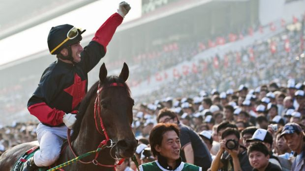 Olivier Doleuze from France celebrates after winning the Cathay Pacific Hong Kong Mile race on 'old timer' Good Ba Ba.