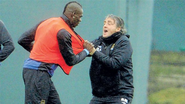 Breaking point: Tempestuous Manchester City striker Mario Balotelli clashes with manager Roberto Mancini.