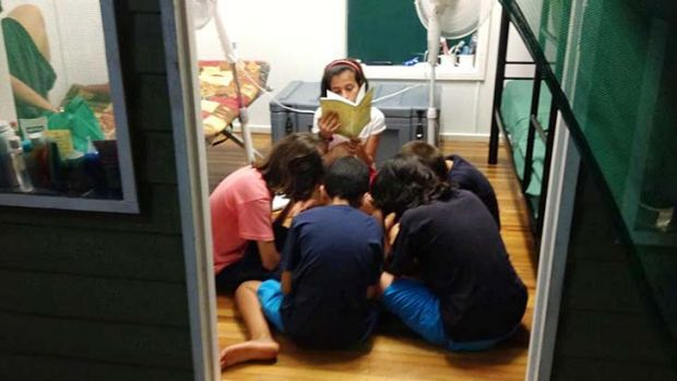 On the inside: Children gather in a detention centre room with virtually no protection from malaria-carrying mosquitoes.