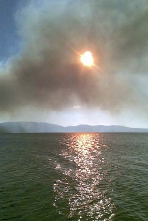 An out of control bushfire burning at the edge of Wallis Lake.